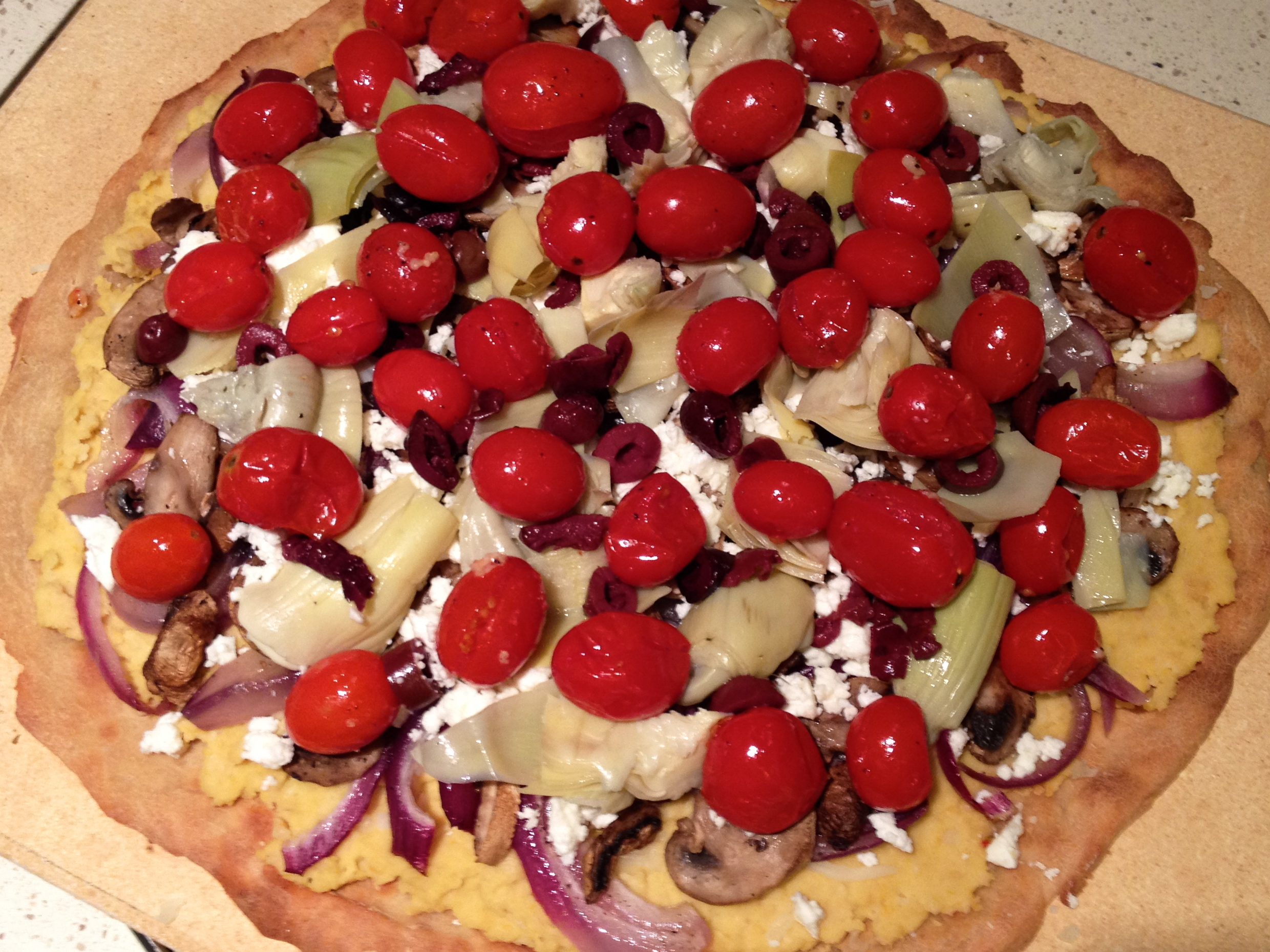 Add kalamata olives and tomatoes